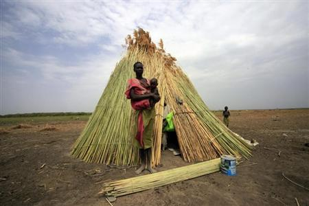 A woman from the Dinka tribe stands in front of her shelter near Bor, Jonglei state March 31, 2012. REUTERS/ Mohamed Nureldin Abdallah