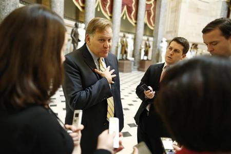 U.S. Representative Mike Rogers (R-MI) (left) talks to reporters at the U.S. Capitol in Washington in this file photo taken December 31, 2012. REUTERS/Jonathan Ernst
