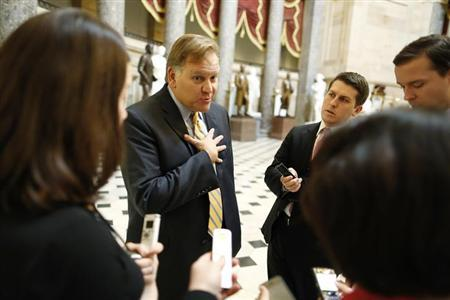 U.S. Representative Mike Rogers (R-MI) (left) talks to reporters at the U.S. Capitol in Washington December 31, 2012. REUTERS/Jonathan Ernst/Files