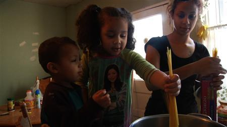 Barbie Izquierdo and her two children cook dinner in the film ''A Place at the Table'' in this undated publicity handout photo courtesy of Magnolia Pictures. REUTERS/Magnolia Pictures/Handout