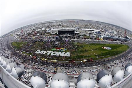 Crowds gather on the track before the start of the NASCAR Sprint Cup Series Daytona 500 race at the Daytona International Speedway in Daytona Beach, Florida February 24, 2013. REUTERS/Pierre Ducharme