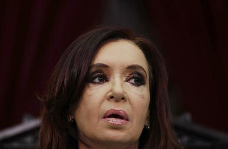 Argentina's President Cristina Fernandez de Kirchner looks on after arriving for the opening session of the 131st legislative term of Congress in Buenos Aires, March 1, 2013. REUTERS/Marcos Brindicci
