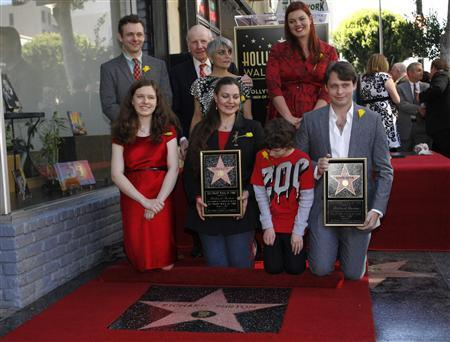 Family members and friends pose together during a ceremony posthumously honoring actor Richard Burton with a star on the Hollywood Walk of Fame in Hollywood, California, March 1, 2013. REUTERS/Jonathan Alcorn