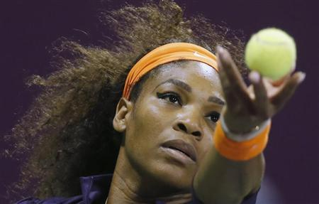 Serena Williams of the U.S. serves the ball to Victoria Azarenka of Belarus during the final match at the Qatar Open tennis tournament in Doha February 17, 2013. REUTERS/Fadi Al-Assaad