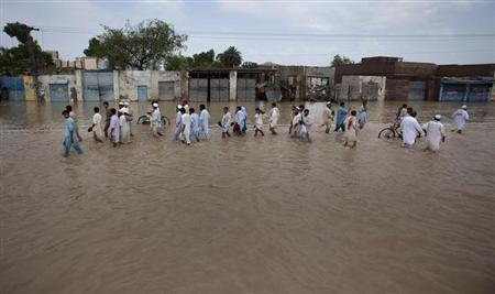 In this image taken on August 1, 2010, residents are seen returning to the town of Nowshera, northwest Pakistan as flood waters started to recede. REUTERS/Adrees Latif/Files
