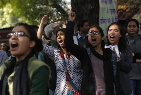 Demonstrators shout slogans during a protest near parliament in New Delhi February 21, 2013. REUTERS/Adnan Abidi/Files