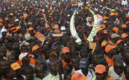 Supporters of Kenya's Prime Minister Raila Odinga, the presidential candidate of the Coalition for Reforms and Democracy (CORD) attend his campaign rally in the western city of Kisumu, March 1, 2013. REUTERS/Moses Eshiwani