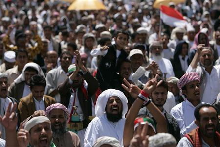 Pro-democracy protesters shout slogans during their weekly rally in Sanaa March 1, 2013. REUTERS/Khaled Abdullah