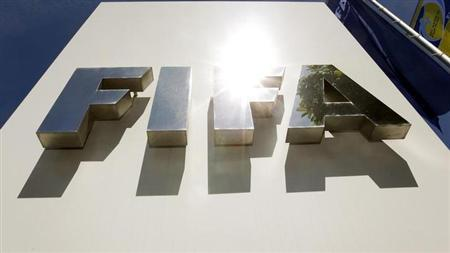 The sun is reflected on the FIFA logo in front of the FIFA headquarters in Zurich May 29, 2011. REUTERS/Arnd Wiegmann/Files