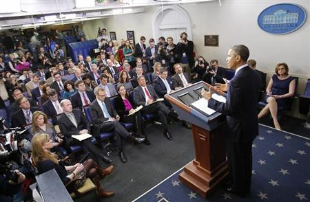 Reporters listen to U.S. President Barack Obama speak about the sequester after he met with congressional leaders at the White House in Washington March 1, 2013. REUTERS/Kevin Lamarque