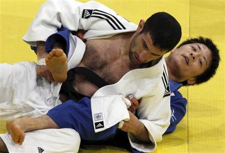Japan's Junpei Morishita (R) challenges Armenia's Armen Nazaryan in their under-66 kg final at the Paris International grand slam judo tournament February 5, 2011. REUTER/Regis Duvignau