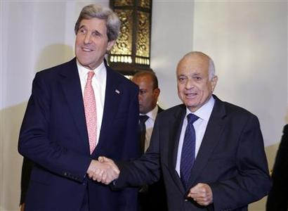 U.S. Secretary of State John Kerry (L) poses for a photograph with Arab League Secretary General Nabil El-Arabi after their meeting in Cairo March 2, 2013. U.S. Secretary of State John Kerry will stress the importance Egypt achieves political consensus for painful economic reforms needed to secure an IMF loan, a senior U.S. official said on Saturday. Kerry arrived in Egypt on his first visit to the Arab world since taking office for talks with the leaders of a country mired in political and economic crisis two years after the overthrow of autocrat Hosni Mubarak. REUTERS/Jacquelyn Martin/Pool