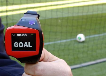 A FIFA official holds a wrist watch used as part of the Hawk-Eye goal-line technology, in Toyota, central Japan December 8, 2012. REUTERS/Toru Hanai/Files