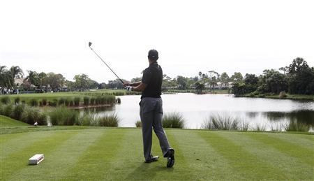Tiger Woods of the U.S. follows through on a tee shot on the 13th hole during the third round play at the Honda Classic PGA golf tournament in Palm Beach Gardens, Florida March 2, 2013. REUTERS/Andrew Innerarity
