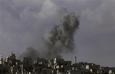 Smoke rises over the Salah al-Din neighbourhood in central Aleppo March 2, 2013. REUTERS/Hamid Khatib