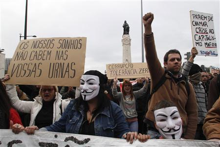 Demonstrators shout while taking part in a march against government austerity policies in Lisbon March 2, 2013. REUTERS/Hugo Correia
