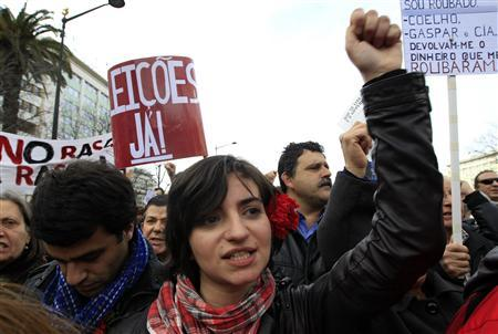 A woman gestures during a march against government austerity policies in Lisbon March 2, 2013. REUTERS/Jose Manuel Ribeiro