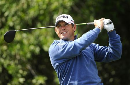 Lee Westwood of Britain hits his tee shot on the 3rd hole during the third round of play in the Honda Classic PGA golf tournament in Palm Beach Gardens, Florida March 2, 2013. REUTERS/Brian Blanco
