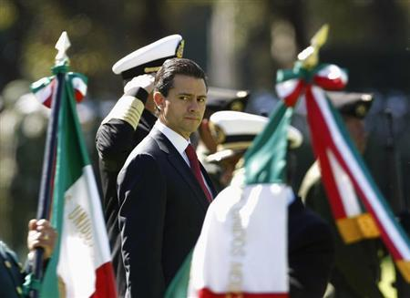 Mexico's President Enrique Pena Nieto looks on during Flag Day celebrations at Campo Marte in Mexico City February 24, 2013. REUTERS/Bernardo Montoya