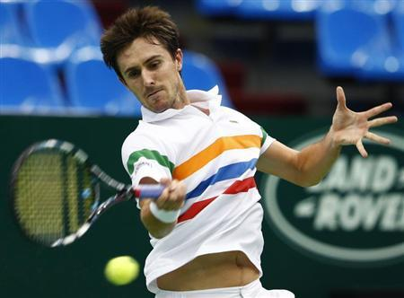 France's Edouard Roger-Vasselin hits a return against Ukraine's Alexandr Dolgopolov during their Kremlin Cup tennis match in Moscow October 18, 2012. REUTERS/Grigory Dukor