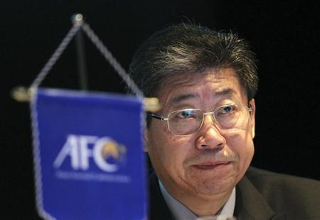 Zhang Jilong, acting president of the Asian Footbal Associations (AFC), listens to a speech during a conference by INTERPOL and FIFA entitled ''Match fixing: The Ugly Side of the Beautiful Game'' for the representatives from the AFC's member associations and law enforcement agencies in Kuala Lumpur February 20, 2013. REUTERS/Samsul Said/Files