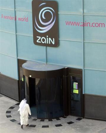 A Kuwaiti man exits the main doors of the Zain Telecommunication head office in Kuwait City October 13,2009. REUTERS/Stephanie McGehee