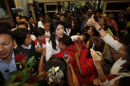 Thailand's Prime Minister Yingluck Shinawatra (C) greets supporters as she arrives to her Puea Thai Party's headquarters in Bangkok March 3, 2013. REUTERS/Damir Sagolj