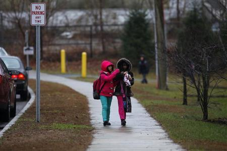 School children walk outside Ellsworth Avenue Elementary School after class was dismissed in Danbury, Connecticut December 17, 2012. REUTERS/Joshua Lott/Files