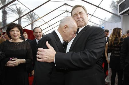 Actors John Goodman (R) and Alan Arkin from ''Argo'' embrace at the 19th annual Screen Actors Guild Awards in Los Angeles, California in this January 27, 2013 file photograph. A new show called ''Alpha House,'' whose pilot filmed in New York late February 2013, has many of the ingredients necessary for television success. Goodman, coming off notable roles in Oscar-winning movies ''Argo'' and ''The Artist,'' is the star. REUTERS/Mario Anzuoni/Files