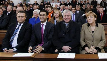 German Interior Minister Hans-Peter Friedrich (L-R), Economy Minister Philipp Roesler, Bavarian Prime Minister Horst Seehofer and German Chancellor Angela Merkel attend a Roman Catholic service for Pope Benedict XVI at Berlin's Hedwig Cathedral church February 28, 2013. REUTERS/Tobias Schwarz
