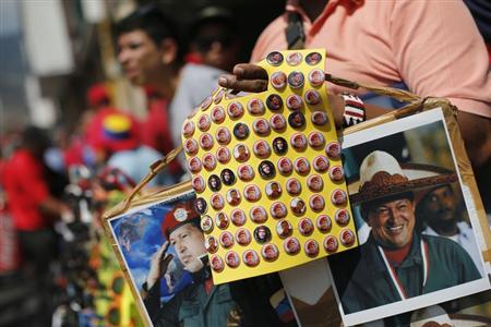 Souvenirs bearing images of Venezuela's President Hugo Chavez are on sale during a rally in Caracas February 27, 2013. REUTERS/Jorge Silva