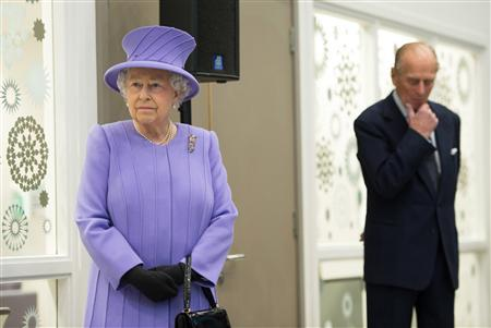 Britain's Queen Elizabeth and her husband Prince Philip pause during a tour of the Royal London Hospital in east London in a February 27, 2013 file photo. REUTERS/Ian Gavan/Pool