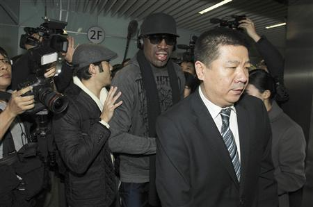 Former NBA star Dennis Rodman (C) is seen surrounded by journalists as he arrives at the Beijing Capital International Airport after his visit to Democratic People's Republic of Korea (DPRK), in Beijing, March 1, 2013. REUTERS/China Daily