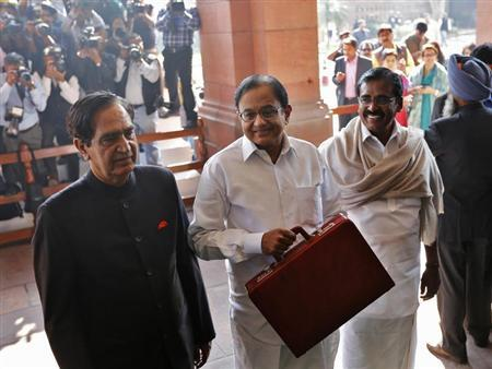 India's Finance Minister Palaniappan Chidambaram (C) arrives at the parliament to present the 2013/14 federal budget in New Delhi February 28, 2013. REUTERS/Adnan Abidi