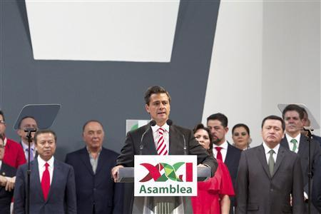 Mexico's President Enrique Pena Nieto (C) speaks at XXI Ordinary National Assembly of the Institutional Revolutionary Party (PRI) in Mexico City in this handout photo provided by the Mexican Presidency March 3, 2013. REUTERS/Mexico Presidency/Handout