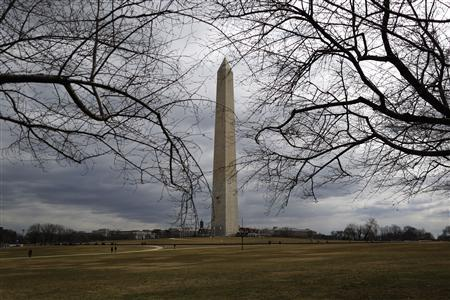 The Washington Monument, currently fenced-in and closed for renovations, is seen in a general view in Washington, March 3, 2013. REUTERS/Jonathan Ernst
