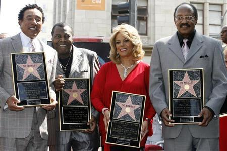 Members of the Motown records R&B music group The Miracles (L-R) Smokey Robinson, Pete Moore, Claudette Robinson and Bobby Rogers pose with their plaques as they were honored with a star on the Hollywood Walk of Fame in Hollywood, California MArch 20, 2009. REUTERS/Fred Prouser