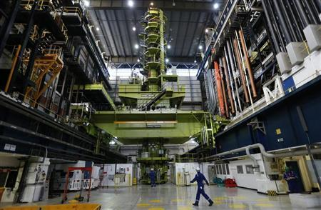 An employee walks through the charge hall inside EDF Energy's Hinkley Point B nuclear power station in Bridgwater, southwest England December 13, 2012. REUTERS/Suzanne Plunkett