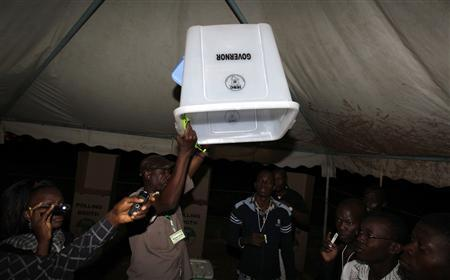 An official from the Independent Electoral and Boundaries Commission (IEBC) confirms an empty voting box before the start of presidential and parliamentary elections in Kisumu, 350 km (217 miles) west of Nairobi March 4, 2013. REUTERS/Thomas Mukoya