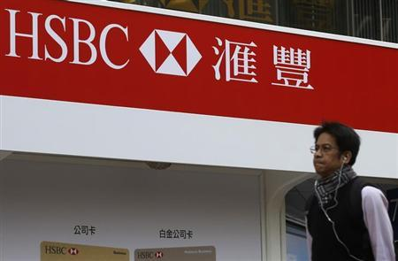 A man walks past an advertisement by HSBC in Hong Kong January 9, 2013. Reuters.REUTERS/Tyrone Siu/Files