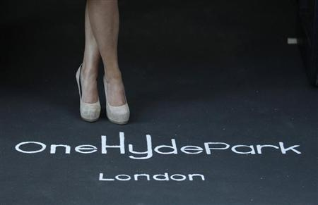 Holly Valance poses for photographers at the launch of One Hyde Park in London January 19, 2011. REUTERS/Luke MacGregor
