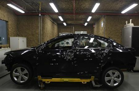 A car with bullet holes is seen during a test at the headquarters of Brazil's Dupont laboratory in Paulinia, 120 km (75 miles) southwest of Sao Paulo April 13, 2012. REUTERS/Nacho Doce