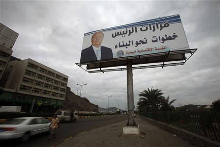A poster of Yemen's President Abd-Rabbu Mansour Hadi is seen on a billboard in the southern port city of Aden February 20, 2013, ahead of planned rallies to mark the first anniversary of ex-president Ali Abdullah Saleh's ouster. REUTERS/Khaled Abdullah