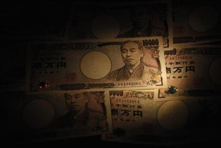 Light is cast on Japanese 10,000 yen notes in Tokyo, in this February 28, 2013 picture illustration. REUTERS/Shohei Miyano