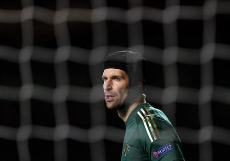 Chelsea's goalkeeper Petr Cech is seen through the net during their Europa League soccer match against Sparta Prague at Stamford Bridge in London February 21, 2013. REUTERS/Eddie Keogh