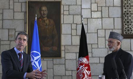 Afghanistan's President Hamid Karzai (R) and NATO Secretary General Anders Fogh Rasmussen attend a joint news conference in Kabul, March 4, 2013. REUTERS/Omar Sobhani
