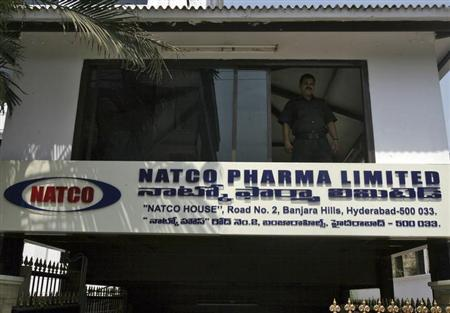 A private security guard looks out from a window of the head office of Natco in the southern Indian city of Hyderabad March 13, 2012. REUTERS/Krishnendu Halder