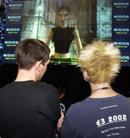 Virtual celebrity Lara Croft speaks to participants attending the 8th annual Electronic Entertainment Expo, about the anticipated release of PlayStation 2's ''Lara Croft Tomb Raider the angel of darkness,'' at the Los Angeles Convention Center in Los Angeles, May 23, 2002. Reuters/Jim Ruymen