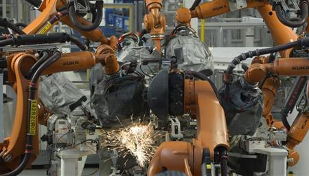 Welding robots are seen in a production line of the Golf VII car at the plant of German carmaker Volkswagen in Wolfsburg, February 25, 2013. REUTERS/Fabian Bimmer