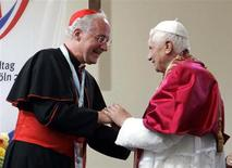 Pope Benedict XVI (R) is greeted by Cardinal Marc Ouellet, Archbishop of Quebec and Primate of Canada during a meeting with seminarians outside St. Pantaleon Church in Cologne, Germany, in this August 19, 2005 file photo. REUTERS/Pier Paolo Cito/Pool/Files